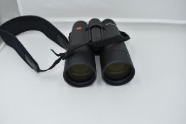 A pair of Leica 'Ultravid' 10 x 50 binoculars, No.1553583, with instruction book and Leica lens