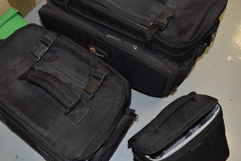 Three Lowepro camera bags