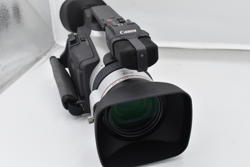 A Canon XM2 3CCD digital camcorder with Canon Fluorite 20 lens, and Canon Wide Converter WD-50, - Image 3 of 4
