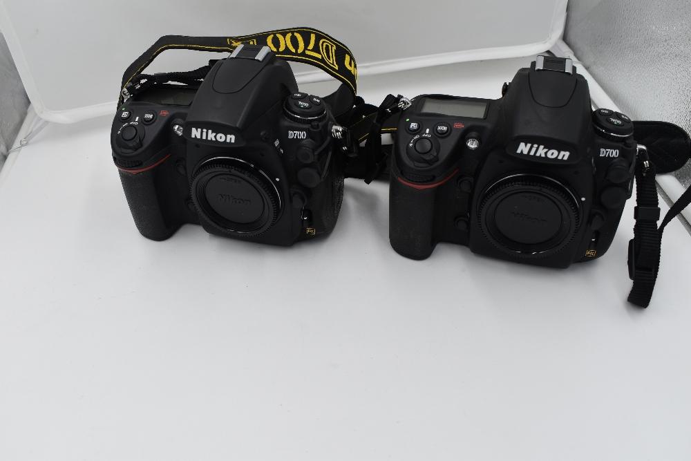 A selection of Nikon cameras and lenses in a hard Peli 1600 case. Two Nikon D700 camera bodies, a