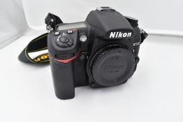 A Nikon camera with lens and equipment in a hard Peli 1600 case. A Nikon D700 body, a Nikon AF-S