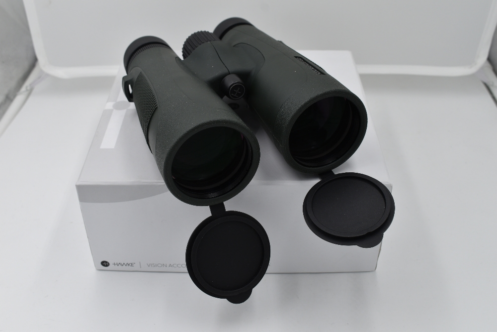 A pair of Hawke Endurance ED 12x50 binoculars in case and with original box