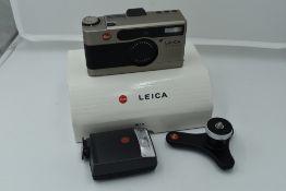 A Leica Minilux Compact Camera, titanium, serial no. 2145366, with Leitz Summarit f/2.4 40mm lens.
