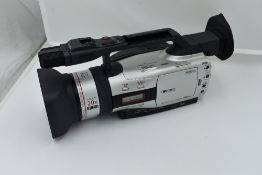 A Canon XM2 3CCD digital camcorder with Canon Fluorite 20 lens, and Canon Wide Converter WD-50,