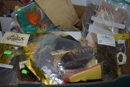 An extensive collection of fly tying equipment including clamp,feathers and braid.