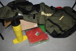 A Snowbee float tube kit unused, including pump and flippers.