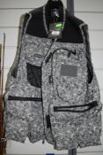A Wychwood long fishing vest,unused with tags, size large.