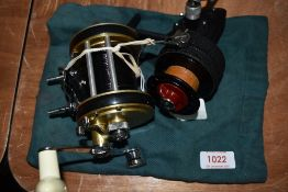 A Dam quick finessa vintage lightweight spinning reel and Policansky monitor no 2 multiplier reel.