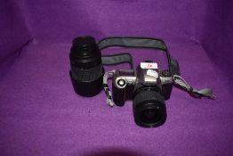 A Nikon F65 camera with an AF Nikkor 28-80mm lens ad a AF Nikkor 70-300mm lens.