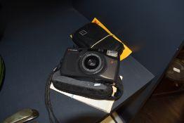 A Kodak pocket instamatic 100 and a Chinon camera.