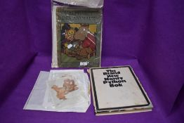A vintage Monty python book, a vintage French childrens book and two vintage Lawson Wood prints.