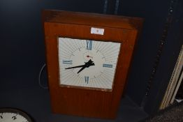 A vintage wooden cased wall clock.