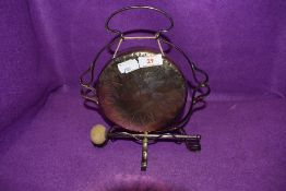 A small plated gong.