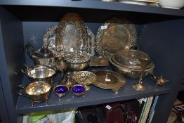 An assortment of plated wares and similar including vases, rose bowl, platters,cruet and more.
