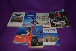 An assortment of Travel guides and gardening books.