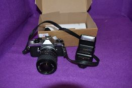 A Pentax ME super camera with a Sigma UC zoom 28-70mm lens and sunpak flash.