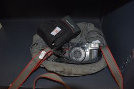 An olympus camera and case.