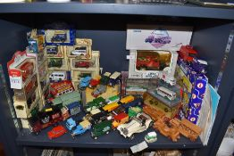 An assortment of collectable vehicles with a good amount still being in boxes includes Corgi,