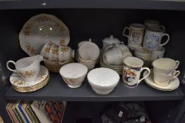 A mixture of ceramics including Colclough cups and saucers, commemorative mugs Stanley china and