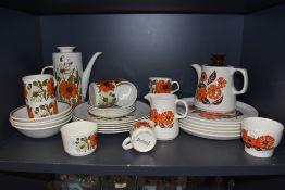 A selection of retro ceramics having vibrant orange floral patterns, one being Barker Bros Orange