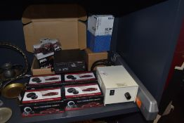Four boxed rear view cameras and a selection of car related accessories including RAC warning