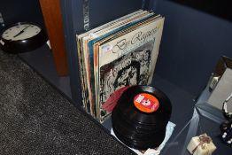 A collection of vinyl LP records and 45 singles including rock and roll, easy listening and more.