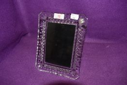 A Waterford crystal photo frame.