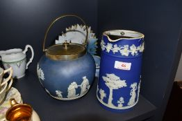 A Wedgwood biscuit barrel and a lidded jug, also included is a small trinket dish.