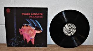 An original UK Vertigo press of Paranoid by Black Sabbath - vinyl is VG+ - would benefit from a