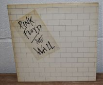A copy of the Wall by Pink Floyd with inners and stickered sleeve