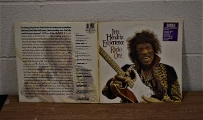 A Jimi Hendrix BBC sessions album on purple vinyl with poster