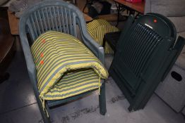 A selection of green plastic garden chairs and complementary cushions