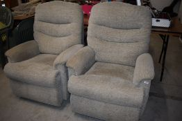Two modern manual recliner armchairs, in cream