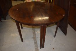 A Georgian mahogany 'D' end dining table having single centre leaf, on square tapered legs, diameter