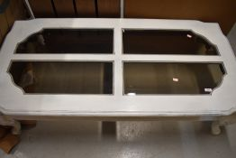 A modern painted coffee table , having smoked glass panels, approx. 137 x 67cm