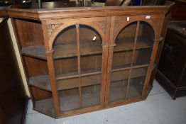 A stripped part glazed dresser back with canted shelf section