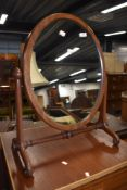 A Victorian mahogany toilet mirror, on turned frame, width approx. 58cm