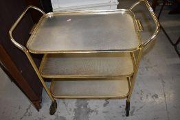 A vintage metal tea trolley