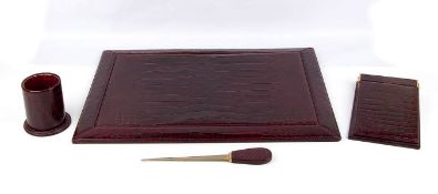 GUCCI DESK SET Late 60s/Early 70s 'Ring' Marine Crocodile skin Desk set, Bordeaux color and gilt