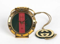 GUCCI TRAVEL WATCH 90s A Gucci 0300 travel watch, quartz movement, gold plated steel, green and