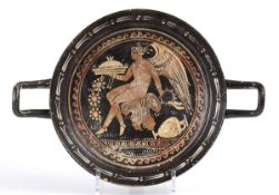 APULIAN RED-FIGURE STEMLESS KYLIX Mid 4th century BC