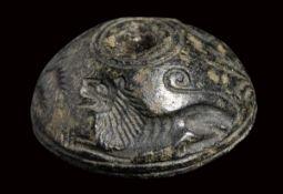 An early greek serpentine engraved seal. Hunting scene.