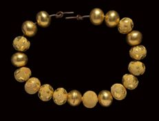 A group of 19 etruscan gold beads.