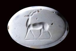 A large eastern greek burnt chalcedony seal intaglio. Deer.
