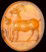 A roman italic carnelian intaglio. Antelope with poppy flower.