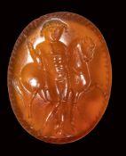 A roman italic carnelian intaglio. Male figure with a horse.
