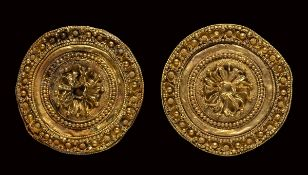 A pair of etruscan gold disc ear-stud.