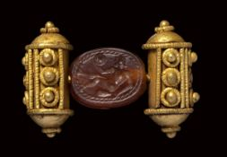 An etruscan carnelian scarab intaglio, mounted on an ancient gold ring. Athlete.