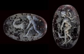 A late hellenistic two-faced glass intaglio. Eros with stag & Eros with a dog.