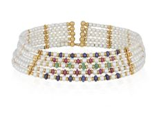 A CULTURED PEARL AND GEM-SET CHOKER, the sprung collar designed as five rows of cultured pearls,